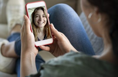 A person hold a phone talking in video calling