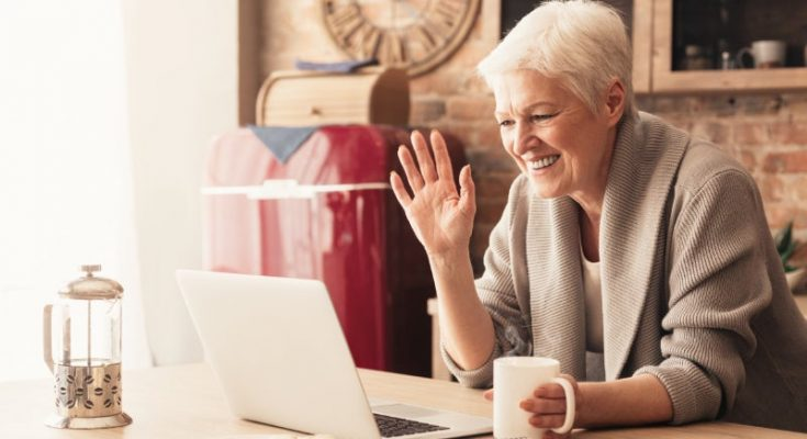 old lady waving using a video chat